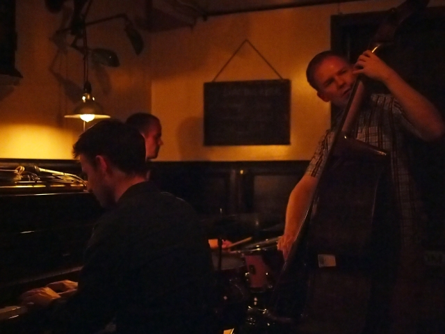Hempel Coleman Trapchak Trio in the low light of Domaine Bar